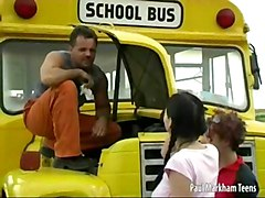 Two Teen Girls Helping A Bus Driver