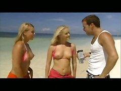 Hot Threesome On The Beach