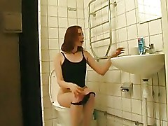 Amateur Redhead Bitch Slurps On Huge Shaft In The Toliet